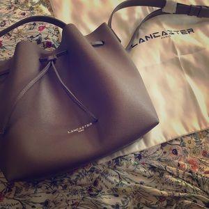 Lancaster Paris taupe leather bucket bag